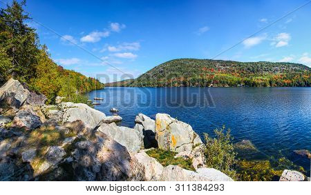 View Of The Water, Rocks And Fall Colors Of Long Pond In Acadia National Park