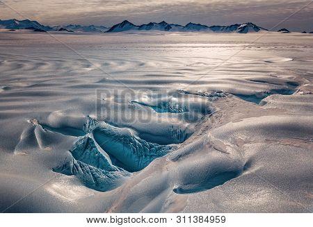Union Glacier In Antarctica. Snowless Arctic Landscape. Waves Of Glacier