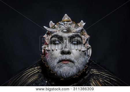 Demon Head On Black Background. Alien Or Reptilian Makeup With Sharp Thorns And Warts, Magic And Fan