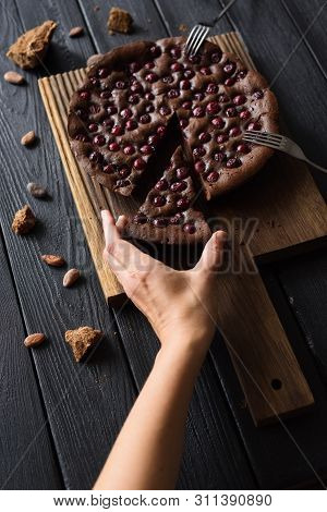 Indulgent Food. Thin Woman Hand Reaching For Chocolate Pie With Cherries On Dark Background Copy Spa