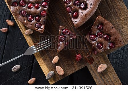 Homemade Comfort Food. Flatlay Of Yummy Chocolate Brownies With Tart Cherries And Cocoa Beans On Dar