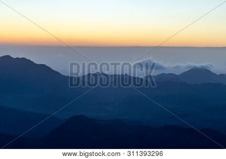 View from the mountain of Moses, a beautiful sunrise in the mountains of Egypt. poster