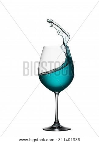 Splash Of Blue Drink In Glass On White Isolated Background. The Splashing Of Blue Water Is Like A Se