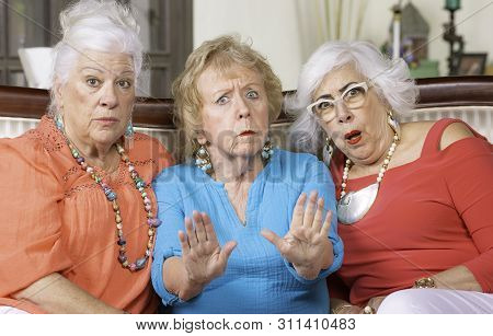 Three Upset Senior Women Expressing Their Displeasure