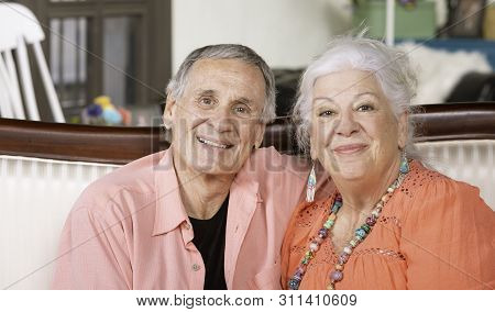Content Senior Man And Woman At Home