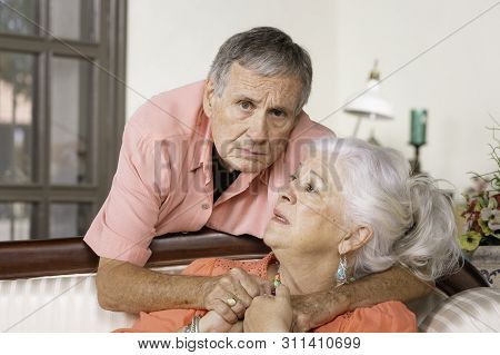 Worried Senior Man And Woman At Home