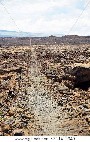Walking Path Through Volcanic Rocks On The Big Island Of Hawaii