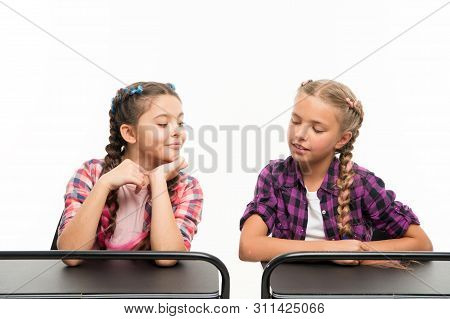 Cheating on the exam. Little schoolchildren passing exam isolated on white. Small girl peeping at her classmate during exam. Their first exam. poster