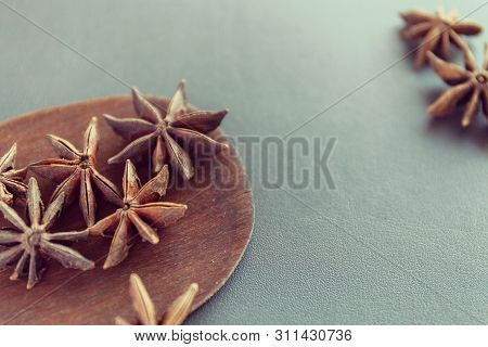 Dry Star Anise On A Brown Wooden Spatula. Natural Food Spices And Seasonings. Tasty Eating. Close-up