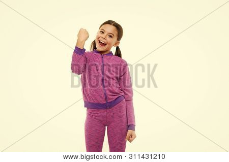 Childrens Day. Portrait Of Happy Little Child. Happy Little Girl With Long Hair. Kid Fashion And Spo