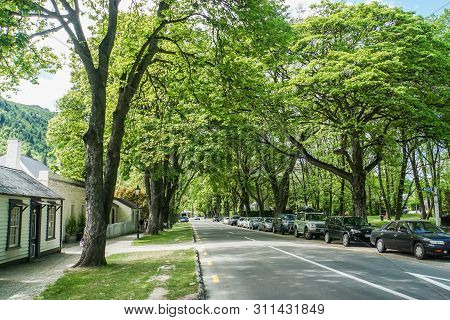 Arrowtown / New Zealand: December 5 2018: Outdoor Parking With Trees In Spring