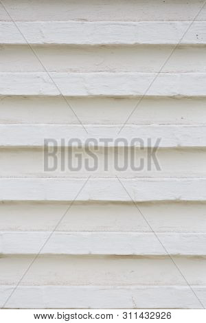 Old Vintage White Brick Wall. Empty Brick Wall Background Of An Industrial Building Exterior Wall. W
