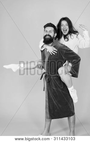 Happy Family. Perfect Morning. Having Fun. Woman And Bearded Man In Robe. Romantinc Couple In Love.