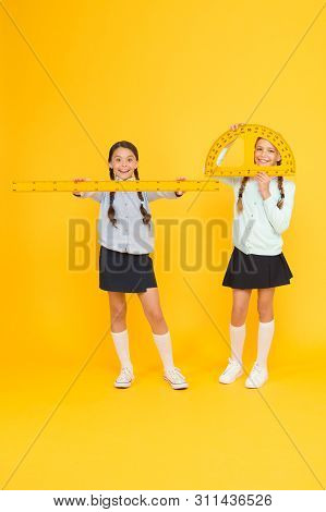 Learning School Geometry. School Children With Measuring Instruments On Yellow Background. Cute Pupi