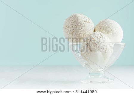 Homemade Creamy Ice Cream Scoops In Transparent Glass Ice-cream Bowl In Modern Pastel Green Interior