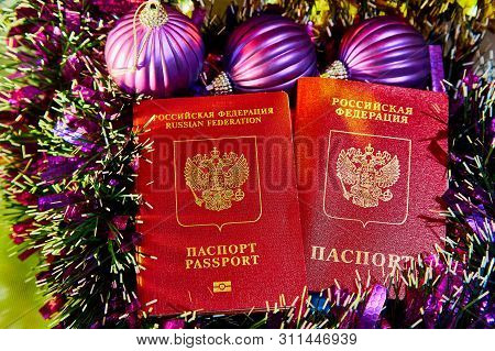 Colorful Christmas tinsel and two passports citizen of Russia poster