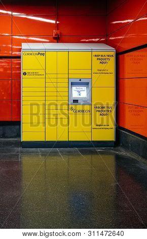 Barcelona, Spain - Jun 3, 2018: Yellow Correos Paq Citypaq Delivery Locker Inside Empoy Metro Statio