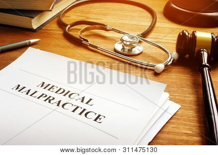 Medical Malpractice Report Documents And The Stethoscope.