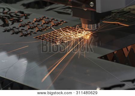 The Fiber Laser Cutting Machine Cutting The Sheet Metal Plate. The Sheet Metal Manufacturing Process