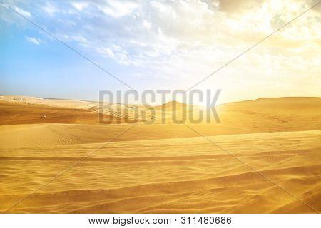 Desert Landscape Sand Dunes At Sunset Sky Near Qatar And Saudi Arabia. Khor Al Udeid, Persian Gulf,