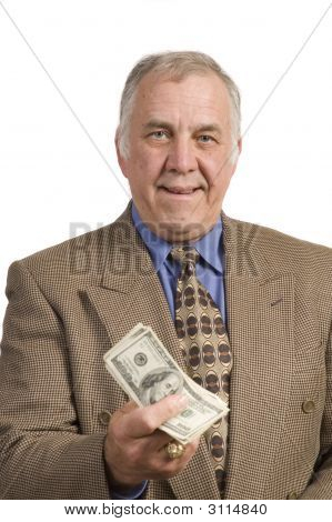 Older Businessman With A Fist Full Of Dollars