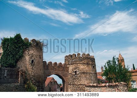 The Walls Of The Old Fortress City Against The Blue Sky,