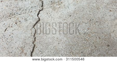 Crack In Concrete. Cracked Foundation. Cracked Road.