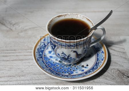 Blue Porcelain Cup With Black Strong Coffee For Moning Breakfast