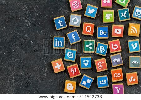 Queenstown, South Africa - 7 July 2019 -social Media Background With Social Media Logos On Wooden Ga