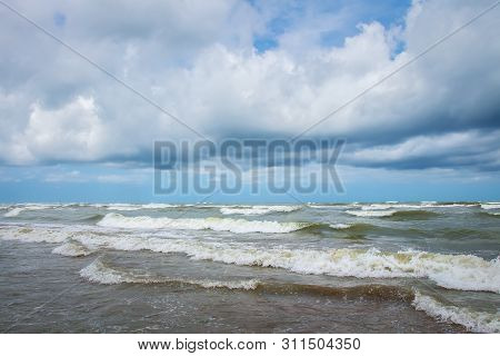 Sea Storm. Big Waves And Strong Wind In The Sea. Clouds In The Sky Over The Raging Ocean.