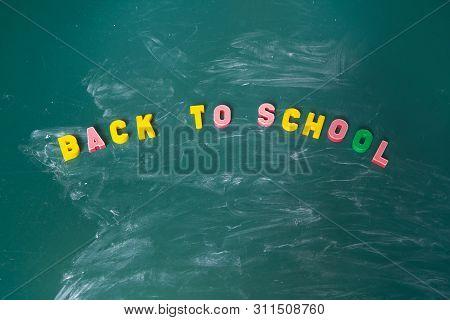 Inscription Back To School. Still Life With School Supplies. Multicolored Chalk. Blackboard In Chalk