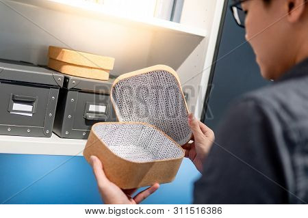 Male Hand Opening Empty Brown Cork Board Box. Packaging Design For Home Decoration Or Office Supplie