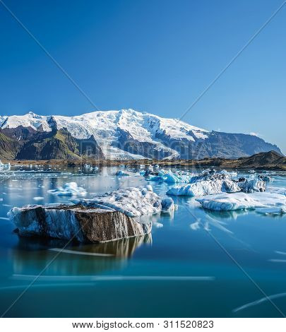 Floating Icebergs In Jokulsarlon Glacier Lagoon In Iceland. Jokulsarlon Is A Glacial Lake In Southea