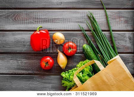 Healthy Food With Fresh Vegetables In Paper Bag On Wooden Background Top View