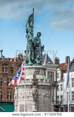 Bruges, Flanders, Belgium -  June 15, 2019: Green Bronze Statue Of Jan Breydel And Pieter De Coninck