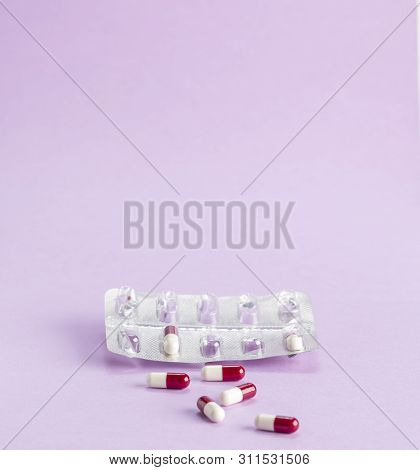Open Blister Pack Of Tablets And A Few Red And White Medicinal Capsules With Atybiotics