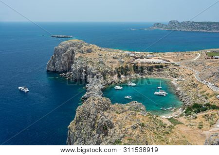 Saint Paul Bay Near Old Town Lindos. Rhodes Greece Europe. Bay In The Shape Of A Heart