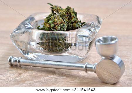 Dry Cannabis Inflorescences And Medical Marijuana Smoking Devices.