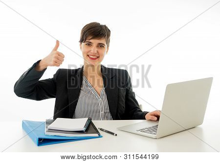 Portrait Of Happy Attractive Young Businesswoman On Laptop Looki