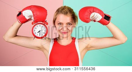 Get Used To Personal Regime. Girl Athlete Boxing Gloves And Alarm Clock. Sport Lifestyle And Healthy