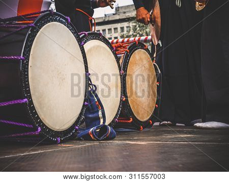 Taiko Drums O-kedo Are In A Row And Japanese Drummers On The Yagura Stage Get Ready To Play. Musical