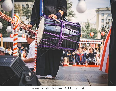 A Male Japanese Musician, A Drummer Standing On The Stage Yagura Is Dressed In Traditional Japanese
