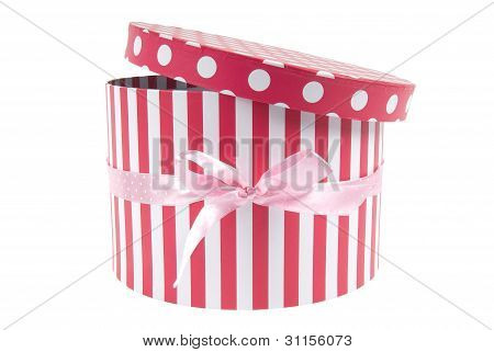 Round box with stripes and dots on white background. Clipping path included