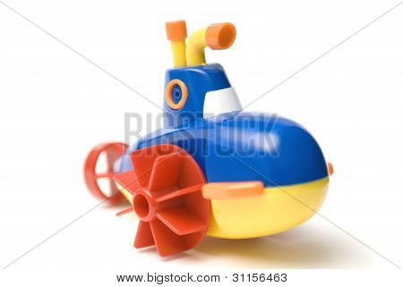 Toy submarine on a white background with shallow depth of field.