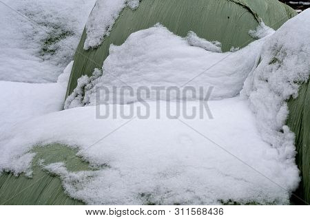 Heap Of Silage Bales On A Farmyard In Winter Covered With Snow