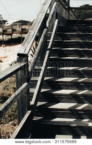 Old Beautiful Wooden Stairways. Wood Stairs With Wrought Iron Railings. Old Vintage White Wood Stair