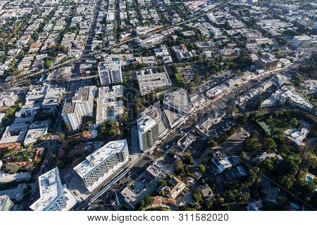 Aerial view of Sunset Blvd area streets and buildings in the West area of Los Angeles County, California.