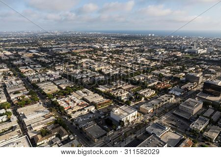 Cityscape aerial view of buildings, homes and streets near Wilshire Blvd in Santa Monica, California.
