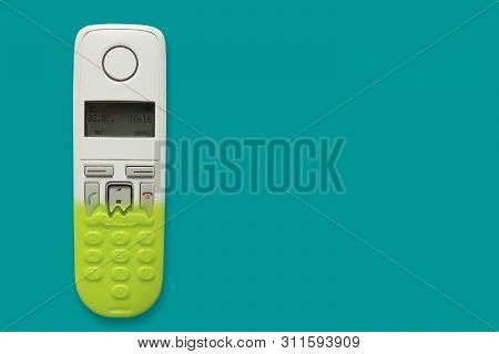 Dect Phone Turning Into A Toy Phone Isolated On Blue Background. The Concept Of Technology Obsolesce