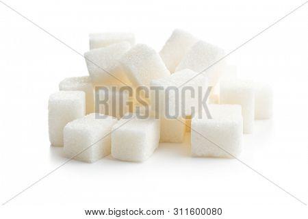 Sweet white sugar cubes isolated on white background.